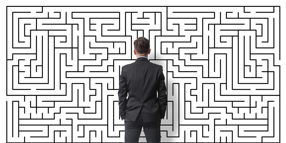 Businessman staring at a maze